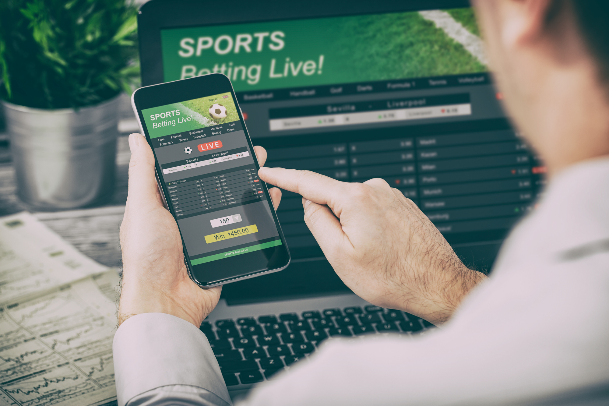 Man checking out sports betting odds